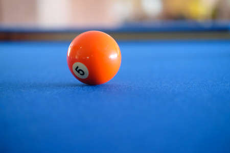 pool game: Billiard cue balls on green table. Pool game, selective focus Stock Photo