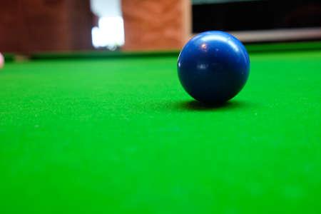 snooker table: Snooker ball on snooker table, blue ball, selective focus