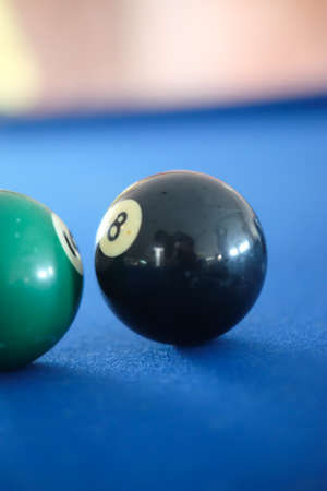 Ball from pool or billiards on a billiard table, selective focus