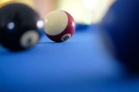 Billiard cue balls on green table. Pool game, selective focus Stock Photo