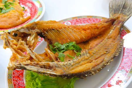 Deep fried snapper topped with sweet fish sauce, Thai food