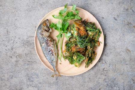 Fried Acacia Pennata, Climbing Wattle with egg and fried mackerel (cha-om kai in Thai)
