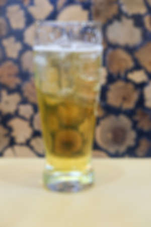 blured: blured background glass of beer on table Stock Photo