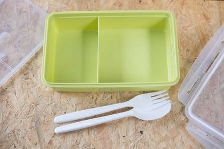 food storage: spoon and fork and empty lunch box for food storage