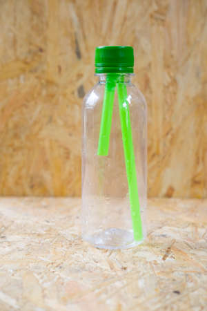 fulfill: Green straws inside a transparent bottle Stock Photo