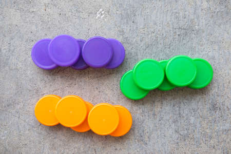 group of multicolored bottle caps, green, orange and violet Stock Photo