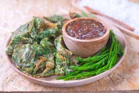 cha om: Fried acacia pennata omelet or cha-om eggs with acacia and spicy shrimp paste