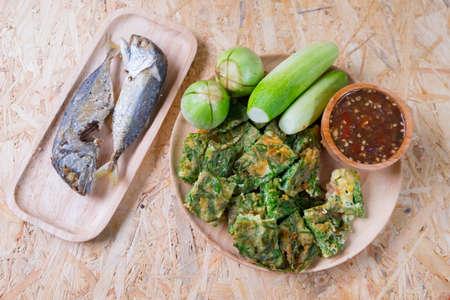 Fried mackerel with shrimp paste sauce, cha-om kai and vegetable set. Thai food Stock Photo