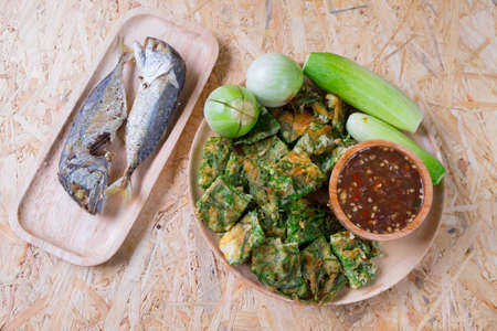 Thai cuisine nam prik or chili paste mixes with fish serves with fried mackerel and various vegetables