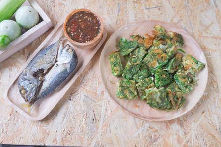 Fried acacia pennata omelet with sauce of shrimp paste and chili (Nam prik kapi) and fried mackerel, Thai Cuisine Stock Photo