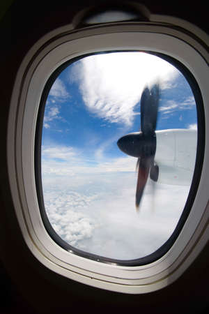plan éloigné: view from the airplane window aircraft propeller nice white clouds and blue sky