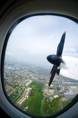 turboprop: Plane propeller seen through the window. Travel concept