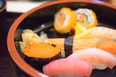 Mix Sushi roll set in wood dish. Sushi is most popular Japanese food in the world Stock Photo