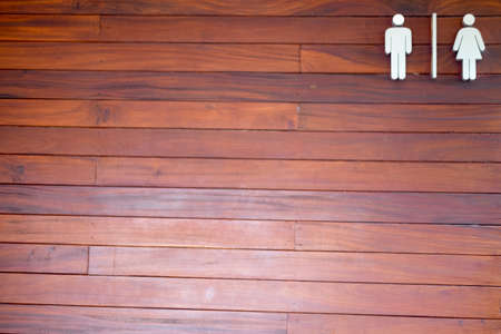Toilet wood sign on wood wall of public restroom