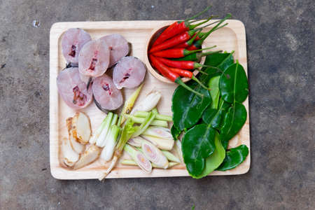 striped snakehead fish: Ingredients of Tom Yam and fish on wood tray Stock Photo