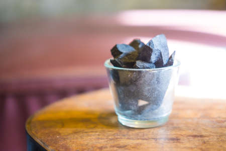 ions: Charcoal arranged in a glass vase. Acts deodorizer which increase negative ions and purifies air