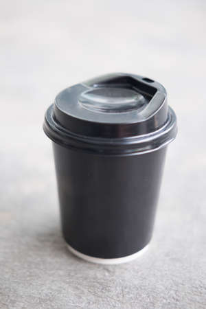 throwaway: Disposable black plastic Cup with a lid. Cup for coffee