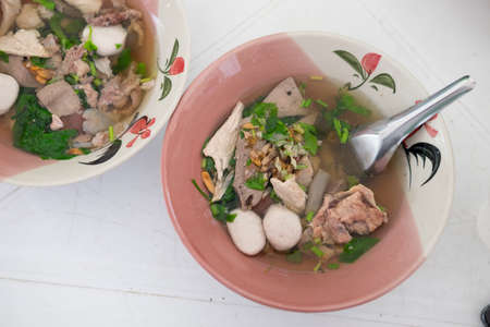 entrails: Boiled pork blood with entrails in soup, top view