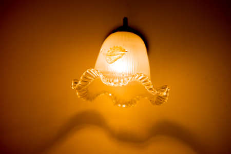 chandelier: Ceiling lamp on wall in home at night