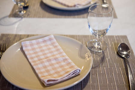 Empty glasses and dishes set in an empty interior new luxury restaurant