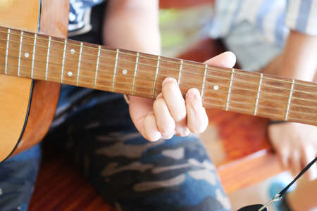 Musician playing acoustic guitar, acoustic guitar guitarist playing details Stock Photo