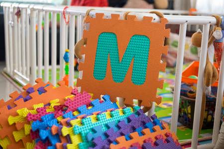 educating: Colored puzzle foam alphabet pieces Stock Photo