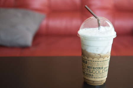 Iced mocha with straw in plastic cup, ice coffee