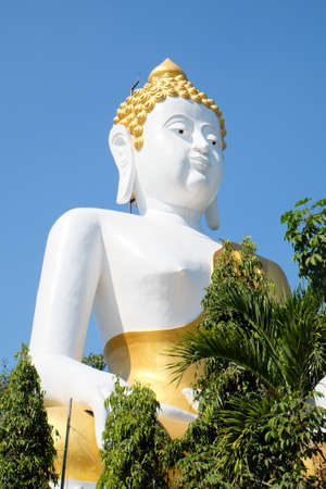 Buddha statue in Phra That Doi Kham temple at Chiang mai, Thailand Stock Photo