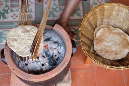 Giant rice crispy grilled on the stove. Thailand ancient dessert