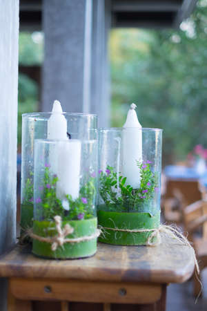 White big candles in glass. Simple creative ideas for home and country house Stock Photo