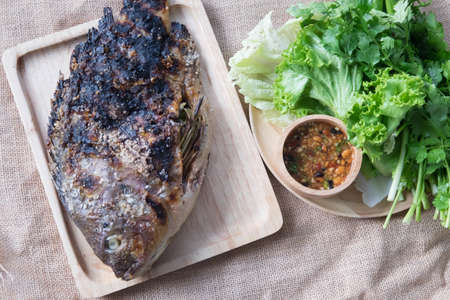 Grill salt Tilapia fish with vegetable and spicy Thai sauce