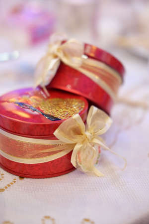 Beautiful wedding favors wrapped in cute boxes, red box Stock Photo