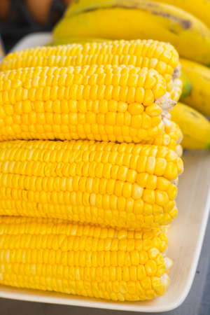 Fresh corn on cobs closeup, food ingredients
