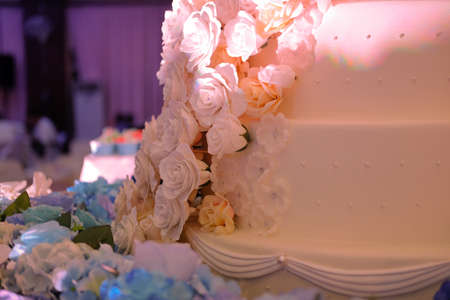 Close up beautiful white wedding cake at wedding reception