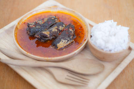 sardine can: Fried mackerel in chilli sauce is made of sweet and spicy chili sauce poured into fried mackerels eating with rice