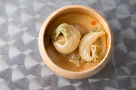 Spicy pickled cabbage salad eat with rice porridge Stock Photo
