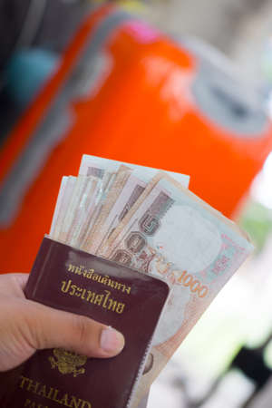 Thailand passport with Thai money ready to travel
