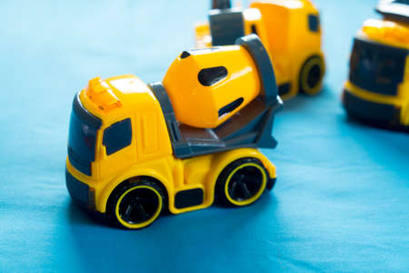 excavate: Construction machinery plastic yellow toy on blue bed