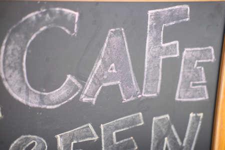 hotel staff: Cafe title written with chalk on blackboard in coffee shop