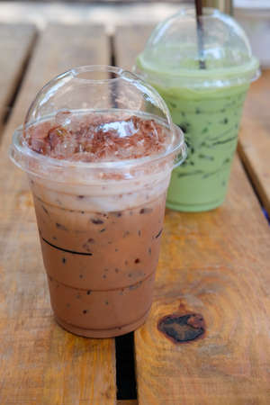 Iced cocoa and ice milk green tea in plastic glass