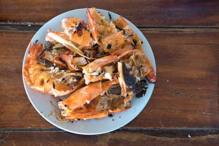 wood stain: Scrap tires shrimp dish on plate at Thailand restaurant