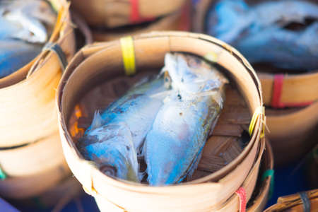 Mackerel fish in bamboo basket at market,  You can find it in every market when you are in Thailand Banco de Imagens - 82802338