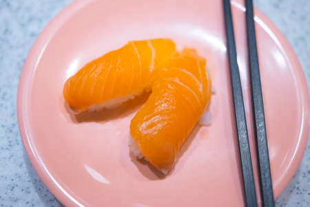 Japanese Sushi - Sake Nigiri Sushi (Salmon Sushi) on pink dish