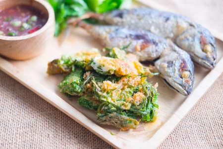 Fried acacia pennata omelet with sauce of shrimp paste and chili (Nam prik kapi) and fried mackerel Stock Photo
