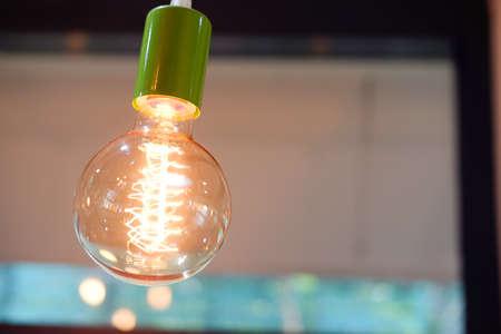 chandelier: Vintage or retro lamp in shop bright in orange light Stock Photo