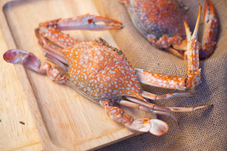 Big crab on wood tray eat with seafood sauce