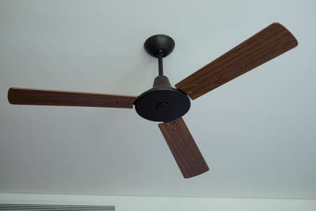 Ceiling fan hanging on the ceiling in living room Stock Photo