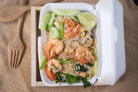 Fried rice with prawn herbs and vegetables in foam box
