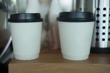 Two coffe paper cup with black cover