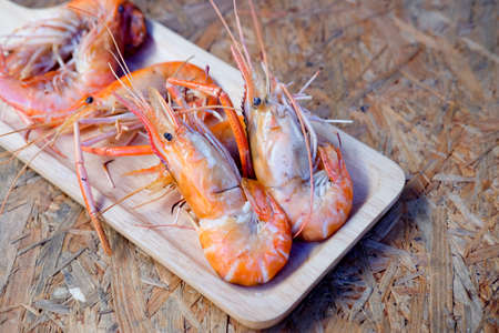 Grilled King prawns or shrimps on wood tray Stock Photo